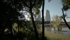 Buenos Aires City Seen From The Eco Park Through Trees While Walking Ungraded Stock Footage