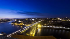 Evening view of Dom Luis Bridge over Duoro river in City of Porto, Portugal Stock Footage