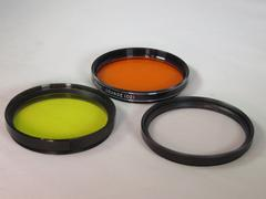 Lens filters (Yellow, orange and UV) - stock photo