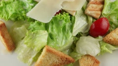 Caesar salad with grilled chicken closeup Stock Footage