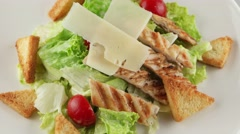 Stock Video Footage of Caesar salad with grilled chicken, cherry tomatoes, croutons