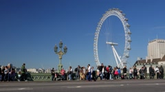Crowds of tourists on Westminster Bridge with taxis driving past. Stock Footage