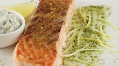 grilled salmon with lemon and sour cream sauce, closeup - stock footage