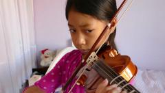 Determined Asian Girl Practising Her Violin-Close Up Stock Footage