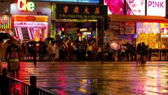 HONG KONG - October 2015: People crossing street in front of Chungking Mansions Stock Footage