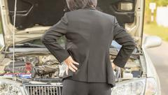 Business woman with her broken car. Stock Photos
