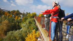 The girl can not get together before jumping from the bridge Stock Footage