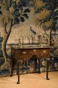 old European lowboy or side table wooden oak against period tapestry - stock photo