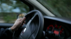 Spinning wheel on very bumpy road - the car goes with a strong shaking Stock Footage
