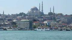 The Golden Horn region of Istanbul with boats and mosques by the river Bosphorus Stock Footage