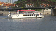 Sightseeing boat floating under the Railway Bridge in Prague Stock Footage