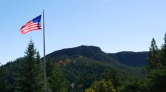 American Flag flies high in the mountains, 4K Stock Footage