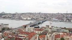 Wide shot of Galata bridge crossing the Bosphorus river in Istanbul Stock Footage