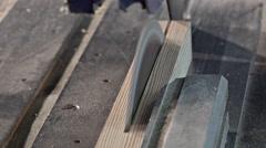 Wood-cutting using a circular saw Stock Footage
