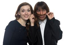 Woman and funny man in jacket Stock Photos