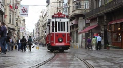 Turkish tram drives away down the Istiklal shopping district - stock footage