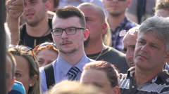 People listening to a speaker and applauding in Prague Stock Footage