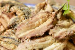 Spanish boquerones fritos, fried anchovies typical in Spain Stock Photos