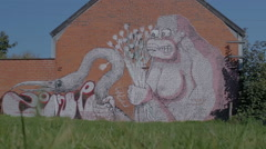 Graffiti of Gorrila with Flowers Grabbing Flamingo - Editorial - 29,97FPS NTSC Stock Footage
