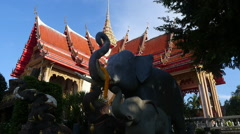 Buddhist wat Temple building with garden and clear sky Stock Footage