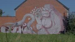 Graffiti of Gorrila with Flowers Grabbing Flamingo - Editorial - 25FPS PAL Stock Footage
