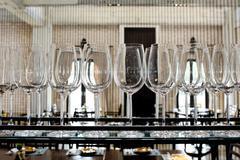 Empty glasses for wine above a bar rack Kuvituskuvat