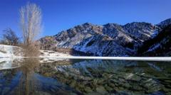 Crystal clear Issyk Lake in mountains near Almaty city in Kazakhstan Stock Footage
