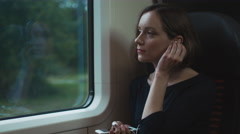 Girl is Listening to a Music during Traveling by Train Stock Footage