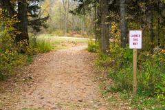 Launch Sign Next to Winding Path - stock photo
