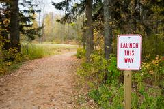 Launch Sign Next to Winding Path Stock Photos
