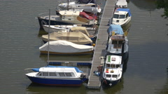 Stock Video Footage of Boats anchored near a pontoon bridge in Prague