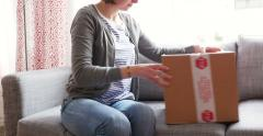 Woman unboxing cardboard box Stock Footage