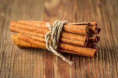 Bunch of cinnamon sticks tied with twine - stock photo