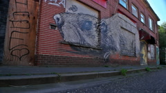 Graffiti on Deserted Shop of Sniffing Rat - Editorial - 25FPS PAL Stock Footage