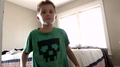 Young Caucasian boy dancing around in his suburban house Stock Footage
