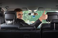 happy adult in car - stock photo