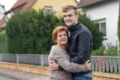 Happy young adult with his grandmother Stock Photos