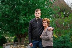 Stock Photo of grandson and grandmother in garden