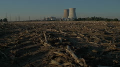 Harvested Field Nuclear Power Plant Sunset - Editorial - 29,97FPS NTSC - stock footage