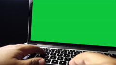 Man typing on laptop with chroma key/green screen. 4k video Stock Footage