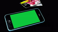 A Smartphone with chroma key/green screen. - stock footage