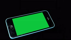 A Smartphone with chroma key/green screen. On black background Stock Footage