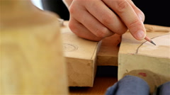 Wood carving - Human hand drawing over a piece of wood before carving it, dolly - stock footage