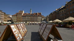 Boards with paintings and drawings in Old Town, Warsaw Stock Footage