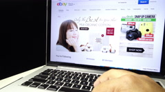 A user is browsing at eBay.com.my on his laptop - stock footage