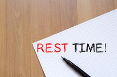 Rest time write on notebook Stock Photos