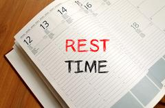 Rest time write on notebook - stock photo