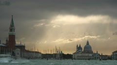 Ferry boat passing by in front of beautiful Venetian sunset scenery Stock Footage