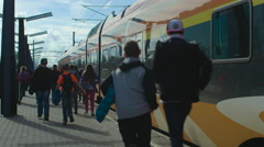 Group of Children with are Running towards Departing Train Stock Footage