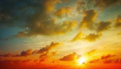 Puffy Clouds Drifting in Timelapse in a Sunset Sky. UltraHD video Stock Footage